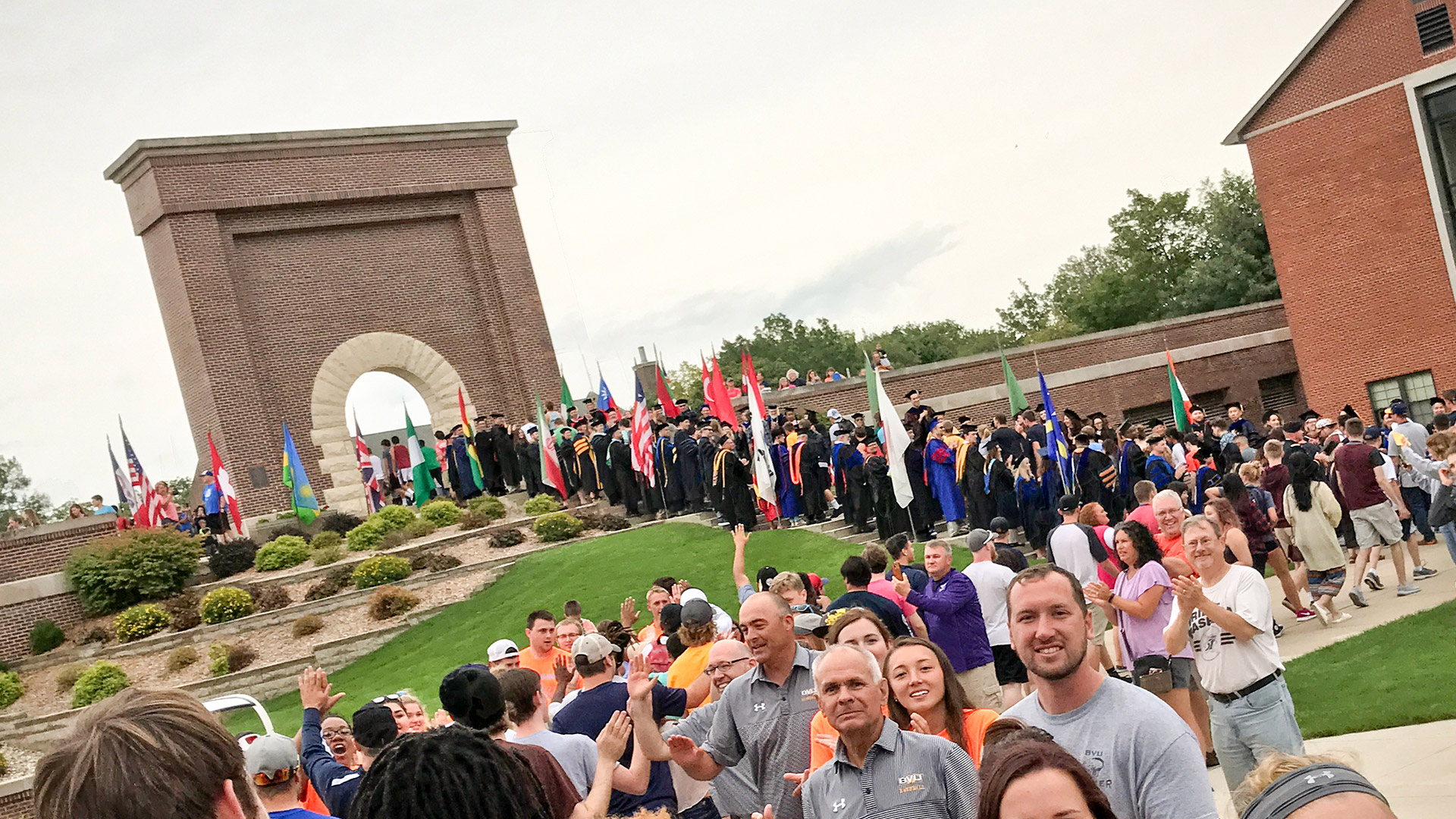 Students walk through Victory Arch