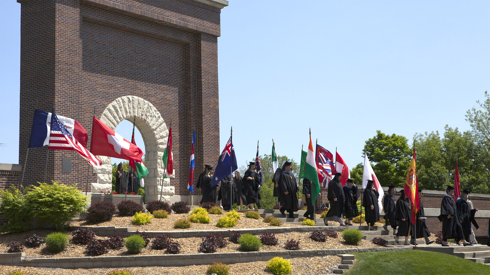 Graduates walking through Victory Arch